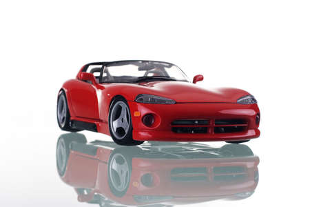 porting: Red car with reflection. Studio shot.