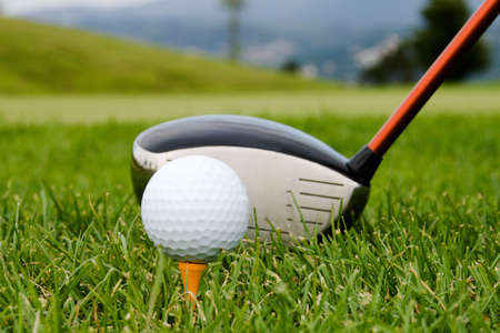 Hitting the ball with a club. photo