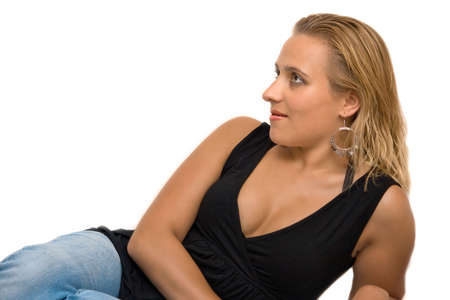 Attractive blond-haired woman sitting in studio with white background photo