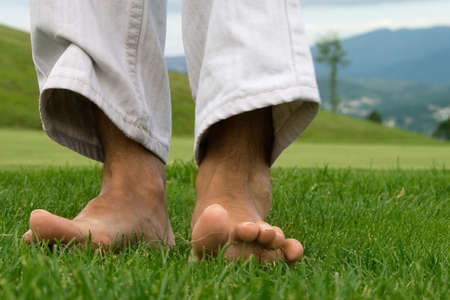 bare women: Sensation of trampling on natural grass