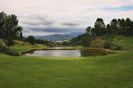 gua: Lake golf course in mountain