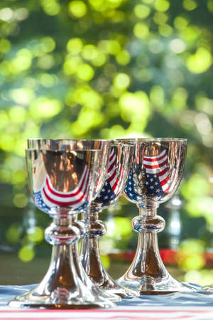 chalices: Silver chalices on the American flag Stock Photo