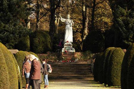 White statue of Christ in autumn