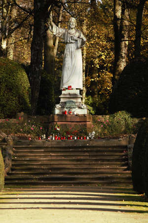 White statue of Christ in autumn