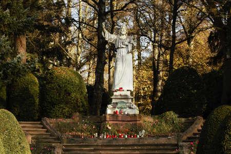 White statue of Christ in autumn photo