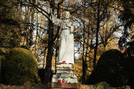 larger than life: White statue of Christ in autumn
