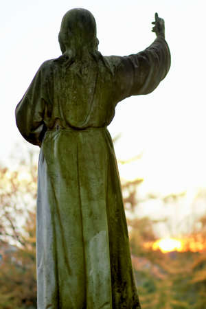larger than life: Statue of Christ in autumn