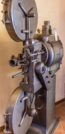 Old movie projector for cinema. Vintage movie camera keep in museum. It is use with retro film. But the body is classic design. The vintage cinema projector is analog and difficult to use it.