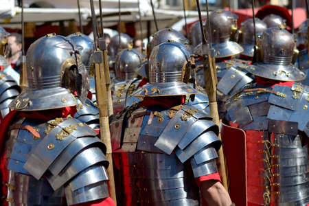 roman soldiers: A group of Roman soldiers parading down the street at Easter.