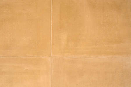 treated: Smooth stone wall blocks of aged brown. The stone has been treated with sand wash. Stock Photo