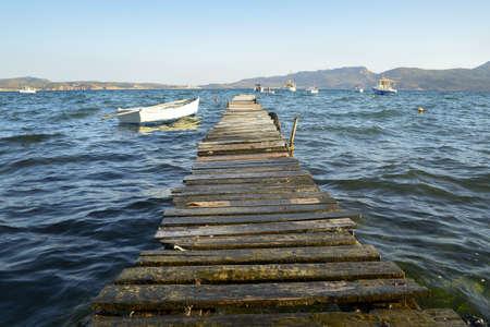 Old footbridge in the bay of Milos  photo