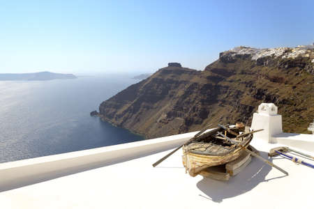 Old boat in Santorini overlooking the caldera and the Aegean Sea