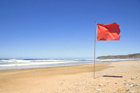 The red flag flutters the beach  This prohibits bathing in the sea by strong waves