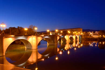 Dusk on the stone bridge on the river Ebro photo