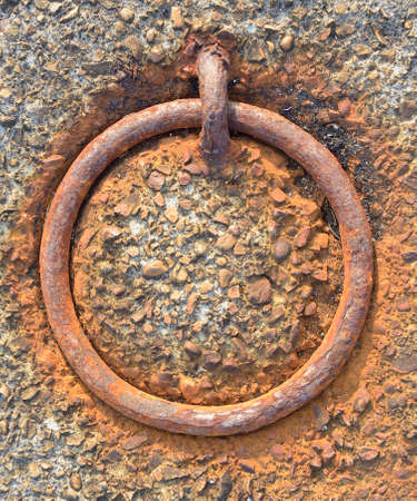 oxidized: Old rusty mooring ring. Oxidized power button.