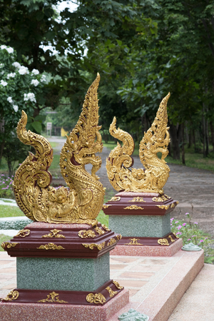 himmapan: Thai traditional sculpture in Buddhist temple, Naga the Magical snake in Himmapan world.