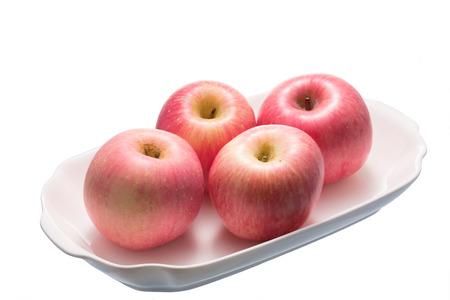 Fresh Fuji apple on white background.