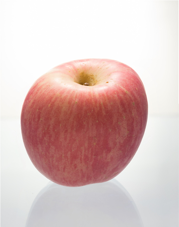 Fresh Fuji apple on white background.
