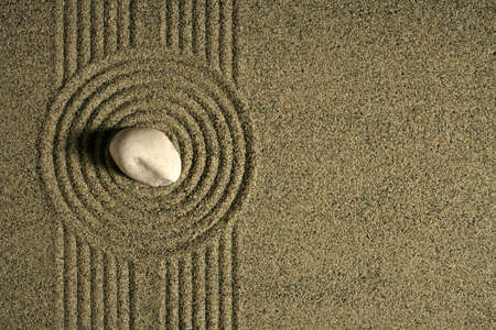 ripple: A single rock sitting in a sand garden. Stock Photo