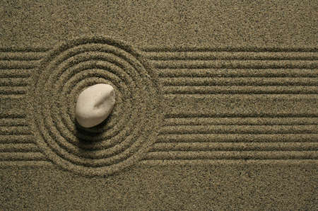 A single rock sitting in a sand garden. Stock Photo - 4774146