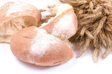 sheaf: Bakery Bread with sheaf of Wheat Ears on white background Stock Photo