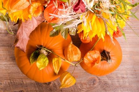 cape gooseberry: Autumn bouquet, pumpkins, cape gooseberry on wooden background