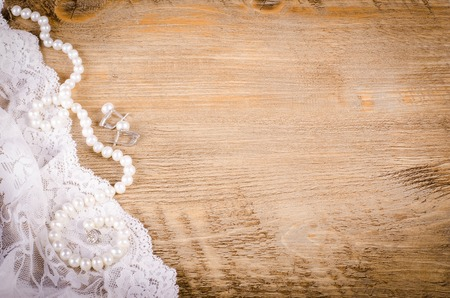 Lace, pearl necklace, earrings and ears of corn