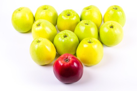 incompatible: Background of green apples with one red apple, isolated