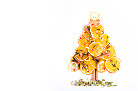 Christmas tree made of dried oranges, cinnamon and anise. Viewed from above.