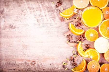 orange peel clove: A closeup of a pile of oranges sliced and lemons sliced on wooden background. Eating frame. Free space for text Stock Photo