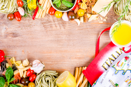ingridients: Ingridients for traditional italian dishes on wooden background. Free space for your text Stock Photo