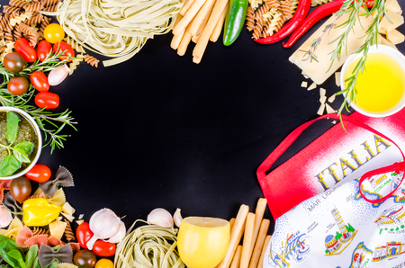 ingridients: Ingridients for traditional italian dishes on black background. Free space for your text Stock Photo