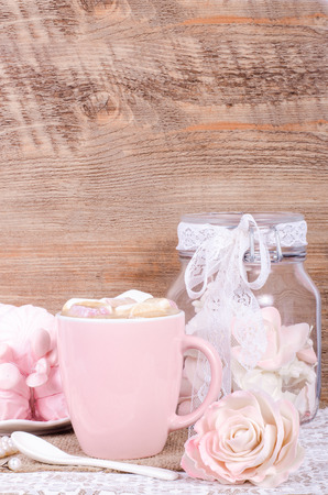 marshmellow: Cute set of pink princess accessories and sweets. Bottle with mastic flowers, big peach rose, zefir, cup of cacao with marshmellow, little spoon and pearl jewerly.