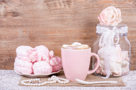 sweet pastries: Cute set of pink princess accessories and sweets. Bottle with mastic flowers, big peach rose, zefir, cup of cacao with marshmellow, little spoon and pearl jewerly.