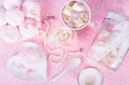 sweet pastry: Cute set of pink princess accessories and sweets. Bottle with mastic flowers, big peach rose, zefir, cup of cacao with marshmellow, little spoon and pearl jewerly.