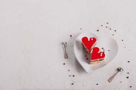 Two jelly heart-shaped cakes on white concrete background. Free space for your text. Toned effect.