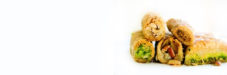 Middle eastern dessert baklava on white background. Free space for your text. Banner