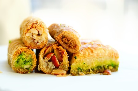 Middle eastern dessert baklava on white background. Free space for your text