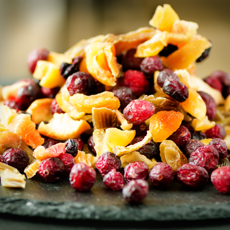 Mix of dried fruits on stone. Cranberry, rhubarb, apple, mango, cherry, peach, apricot. Handmade sweets no sugar. Healthy nutrition, high dose vitamin C. Stock Photo