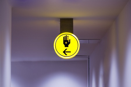 Toilet, wc for hassid (religious Jew) sign. Bright yellow symbol on dark background. Copy space Stock Photo