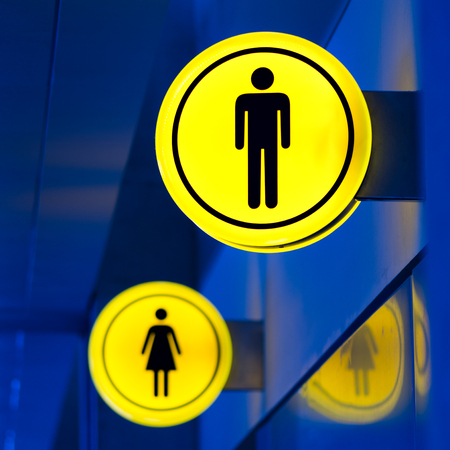 Male, female toilet, restroom sign. Man and woman equality concept. Copy space