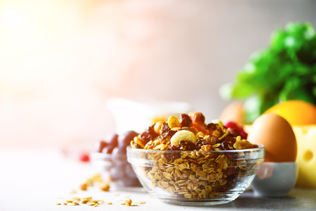 Homemade granola with milk, fresh berries, milk for breakfast. Copy space. Healthy breakfast concept. Sunny morning Stock Photo
