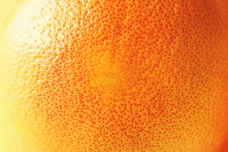 Texture of fresh bright orange peel, closeup, copy space.