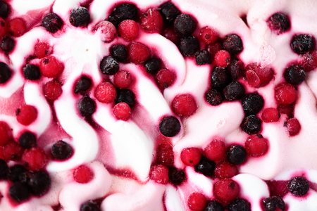Pink ice cream with berries background. Cranberries in frozen ice-cream bowl texture. Copy space
