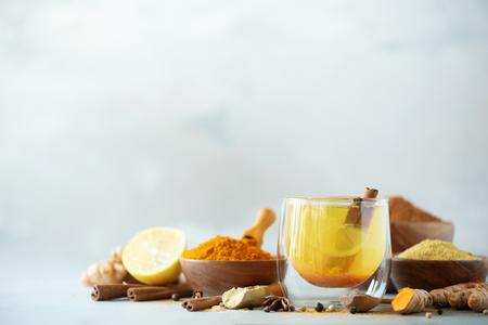 Ingredients for turmeric hot tea on grey