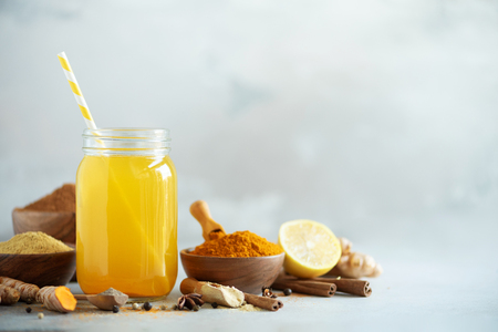 Lemon water with ginger, curcuma, black pepper. Vegan hot drink concept.