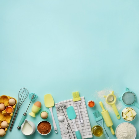 Square crop. Baking ingredients - butter, sugar, flour, eggs, oil, spoon, rolling pin, brush, whisk, towel over blue background. Bakery food frame, cooking concept. Top view, copy space. Flat lay. Archivio Fotografico - 118408762