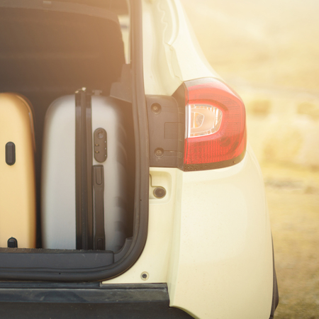 Opened car trunk full of suitcases, luggage, baggage. Summer holidays, travel, trip, adventure concept