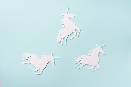 Creative unicorn pattern on blue background. Abstract art texture Minimal fantasy concept. Banner. Top view. Stockfoto