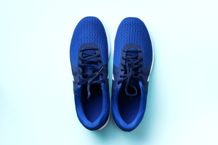 Pair of sport shoes on blue background. Top view, copy space. Fitness, running and sport concept. Healthy lifestyle. Stok Fotoğraf